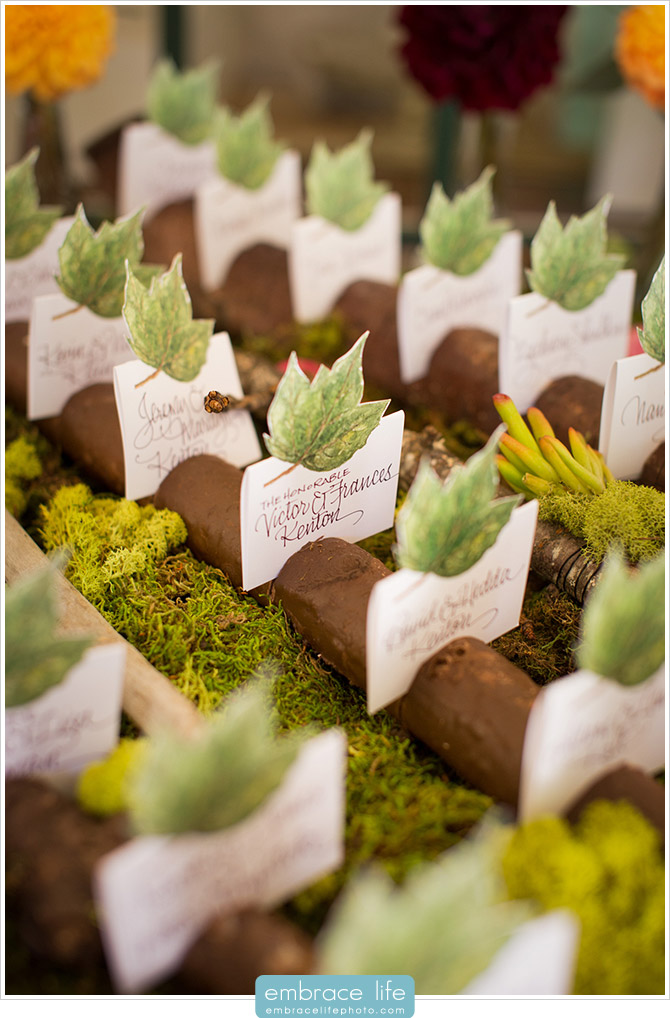 Rustic Escort Cards Featuring Organic Elements Like Moss, Wood and Leaves