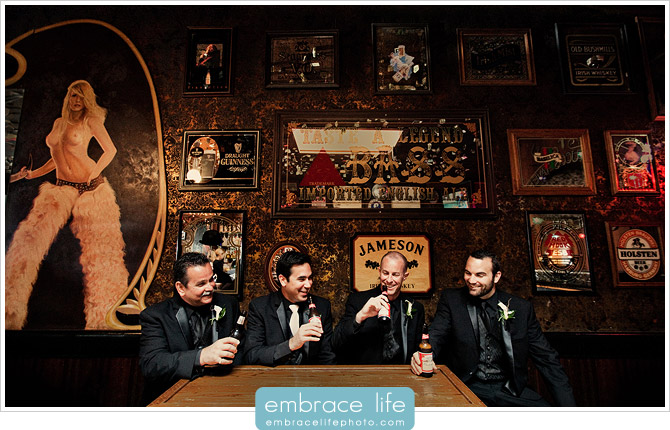 Groom and groomsmen drinking beer in a bar at a Cayucos, CA wedding