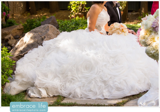 Bride sitting at the Sofreh in her ballroom rose ruffle wedding gown