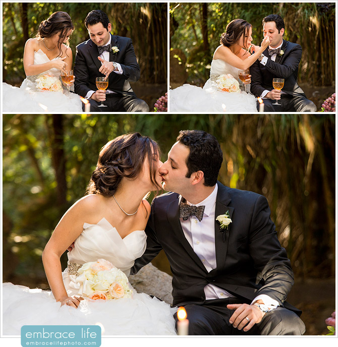 Bride and Groom feeding each other honey and sharing their first kiss during Persian wedding ceremony