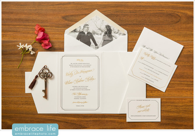 Custom gold foil wedding invitations with envelopes featuring photo liners