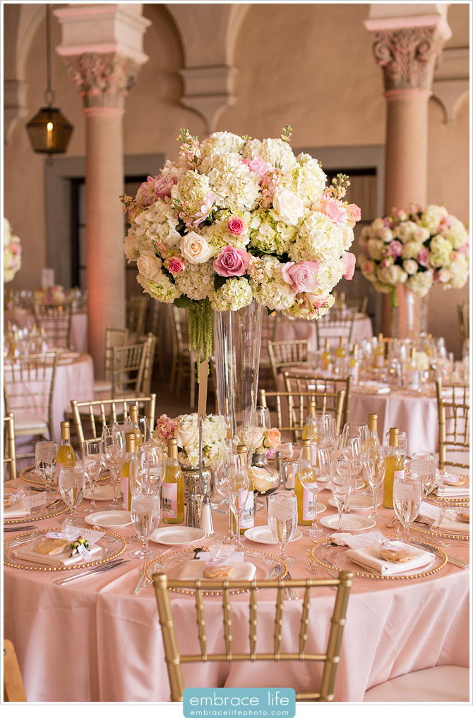 Elevated floral centerpieces with hydrangeas and pink roses at pink wedding reception