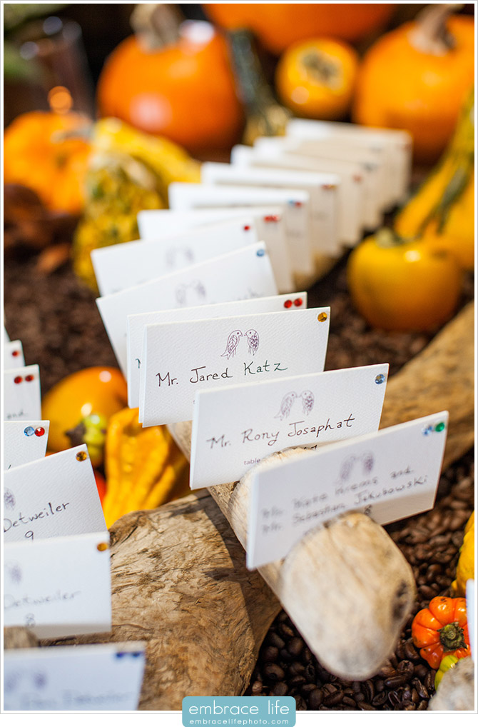 Autumn-themed Fall Wedding Escort Card Display with Pumpkins and Coffee Beans