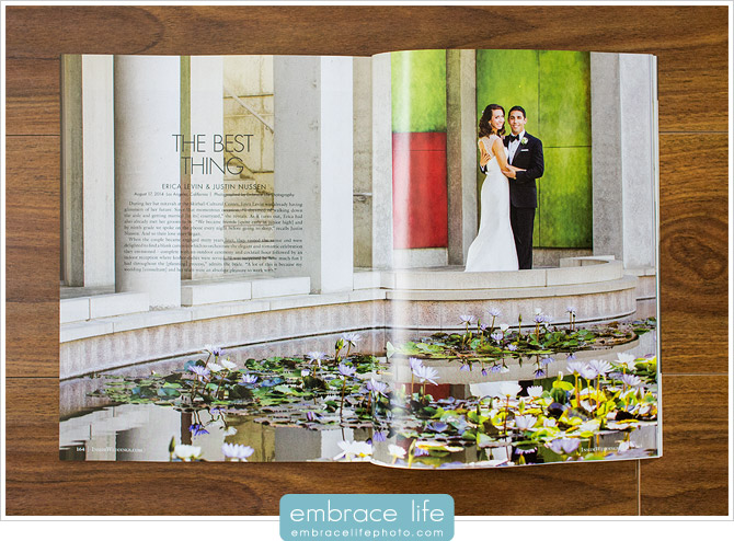 Bride and groom pose in front of colorful wall and reflecting pond at their Skirball Cultural Center wedding